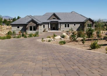 Paver driveways leading towards a cute house | Ipswich Retaining Walls