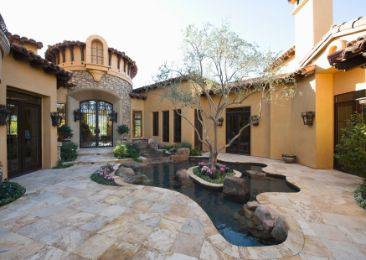 beautiful mansion with a patio and pool paving made of marble | Ipswich Retaining Walls